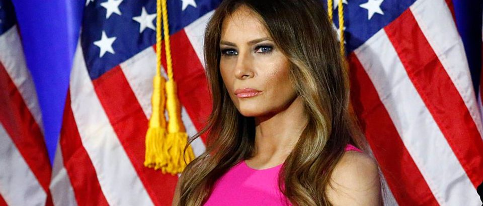 Melania Trump, wife of Republican presidential candidate Donald Trump, listens as her husband delivers remarks at Trump National Golf Club Westchester in Briarcliff Manor, New York, June 07, 2016