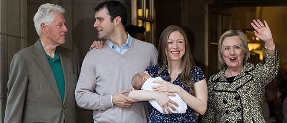 Former President Bill Clinton, Marc Mezvinsky, Chelsea Clinton, holding her newborn son Aidan, and Democratic Presidential candidate Hillary Clinton exit Lenox Hill Hospital on June 20, 2016 in New York City (Getty Images)