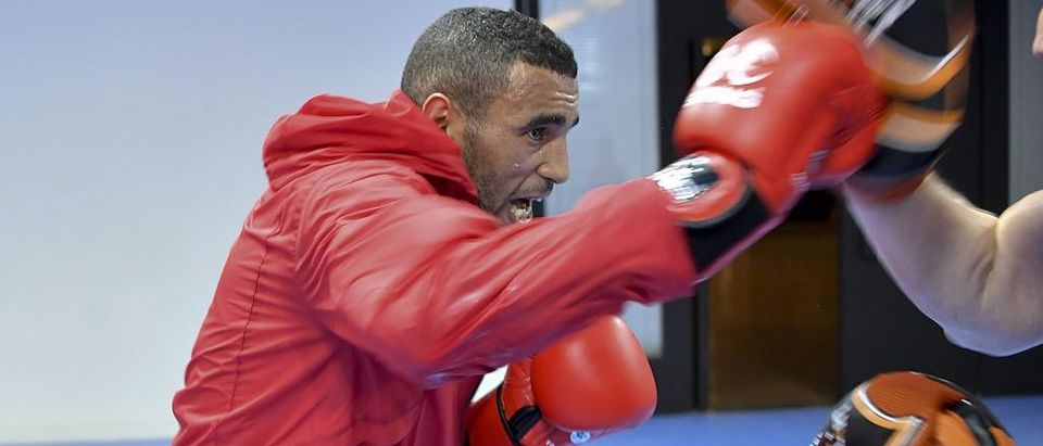 Hassan Saada trains with his coach during a session at the Riocentro complex in Rio de Janeiro (Getty Images)