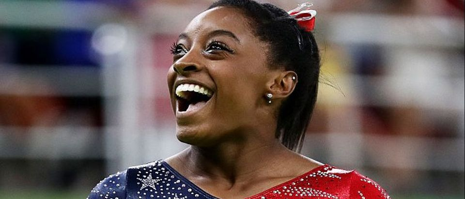 Simone Biles of the United States smiles before competing on balance beam during Women's qualification for Artistic Gymnastics on Day 2 of the Rio 2016 Olympic Games at the Rio Olympic Arena on August 7, 2016 in Rio de Janeiro, Brazil