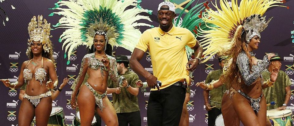 Usain Bolt dances samba during a Jamaican Olympic Association and Puma press conference at the Cidade Das Artes in Rio de Janeiro on August 8, 2016