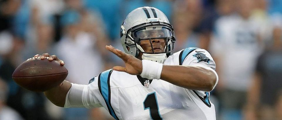 Cam Newton of the Carolina Panthers throws a pass against the New England Patriots in the 2nd quarter during their game at Bank of America Stadium on August 26, 2016 in Charlotte, North Carolina