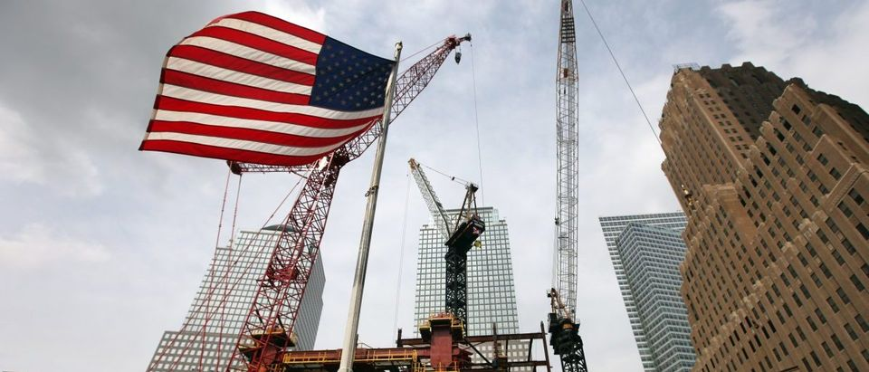 NEW YORK - SEPTEMBER 08: An American flag flies in front of the construction site of One World Trade Center, previously called the Freedom Tower, at the former World Trade Center site on September 8, 2009 in New York City. Eight years after the September 11th terror attacks on the World Trade Center, New York City continues to rebuild the site in lower Manhattan. (Photo by Rick Gershon/Getty Images)