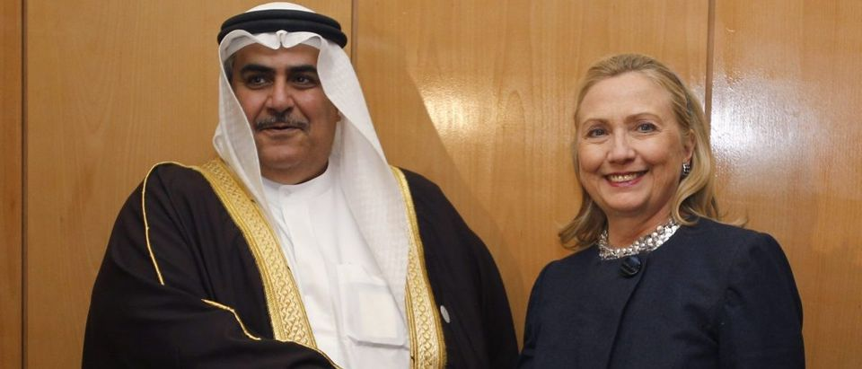 U.S. Secretary of State Hillary Clinton meets with Bahrain's Foreign Minister Sheikh Khaled bin Ahmed al-Khalifa at the Friends of Syria Conference in Tunis