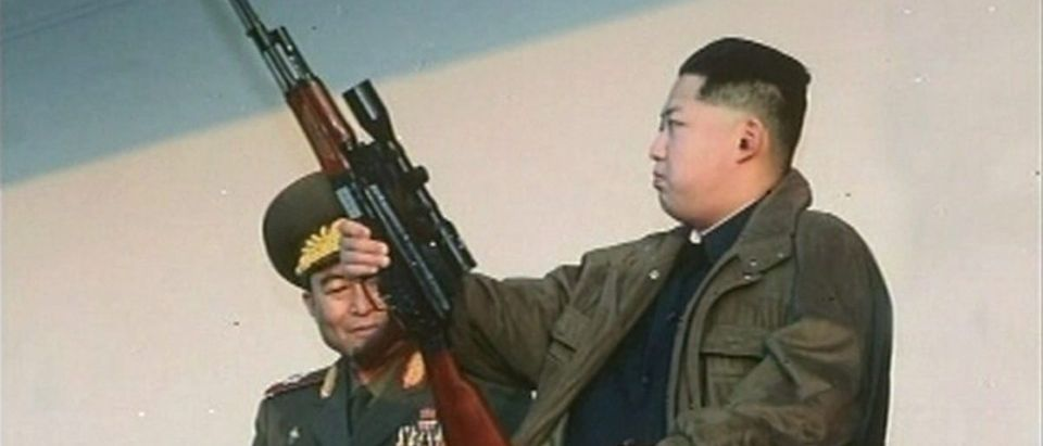 New leader of North Korea Kim Jong-un holds a weapon in this undated still image taken from video at an unknown location in North Korea