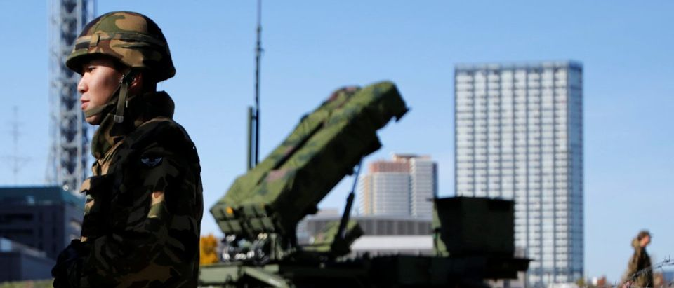 File photo of members of the Japan Self-Defence Forces standing guard near Patriot Advanced Capability-3 (PAC-3) land-to-air missiles, deployed at the Defense Ministry in Tokyo