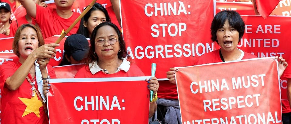 Filipino and Vietnamese activists display placards during a rally over the South China Sea disputes in front of a Chinese Consulate in Makati city, metro Manila