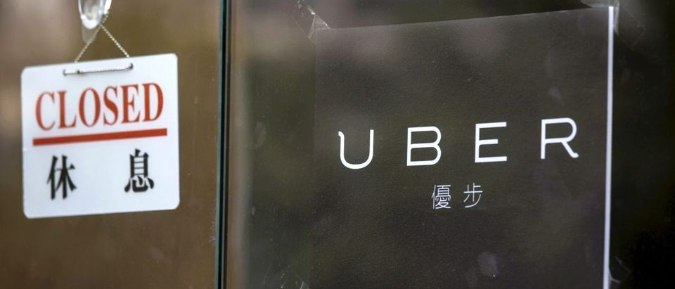 A closed sign is seen at the office of taxi-hailing service Uber Inc in Hong Kong, China