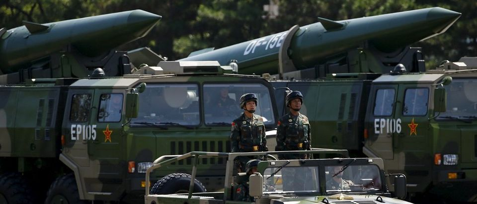 Military vehicles carry DF-15B short-range ballistic missiles during the military parade to mark the 70th Anniversary of the end of World War Two, in Beijing