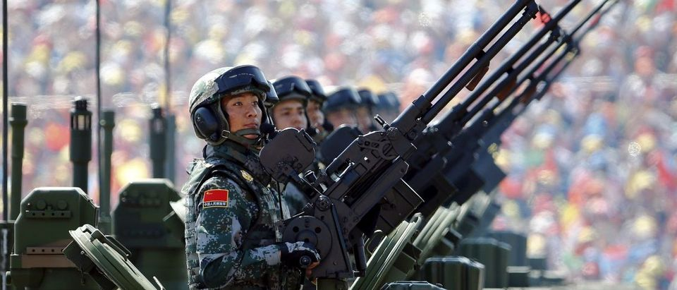Soldiers of the People's Liberation Army (PLA) of China arrive on their armoured vehicles at Tiananmen Square during the military parade marking the 70th anniversary of the end of World War Two, in Beijing