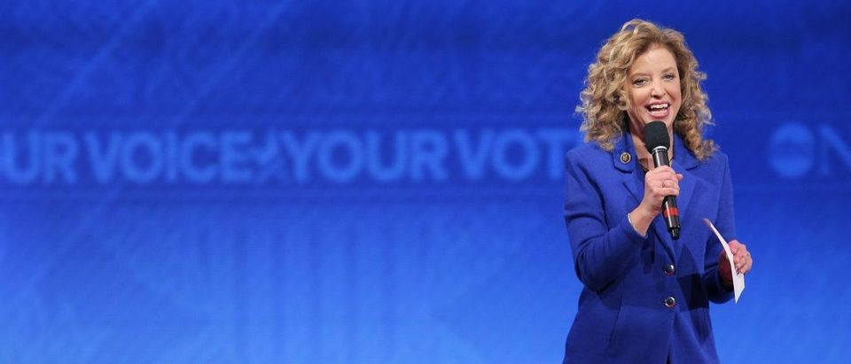 Democratic National Committee Chair and U.S. Rep. Debbie Wasserman Schultz speaks to the audience before the start of the Democratic presidential candidates debate at St. Anselm College in Manchester