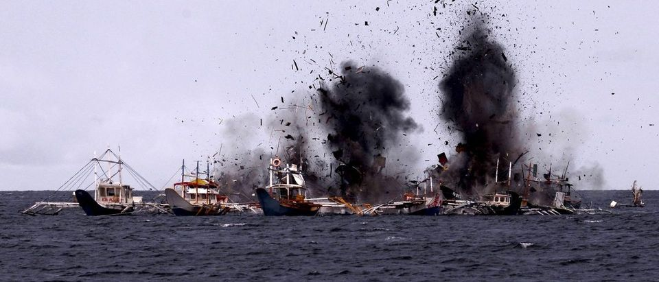 Foreign fishing boats seized for illegal fishing are blown up near Bitung, North Sulawesi, Indonesia
