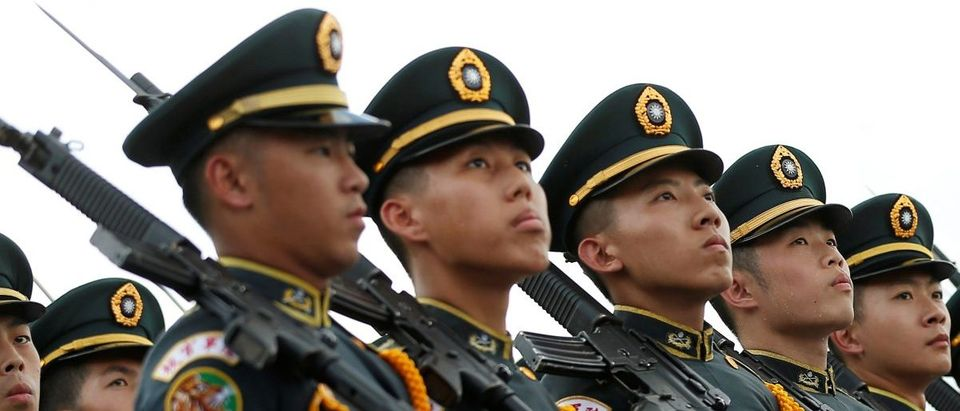 Taiwanese cadets march during a ceremony to mark the 92nd anniversary of the Whampoa Military Academy, in Kaohsiung, southern Taiwan