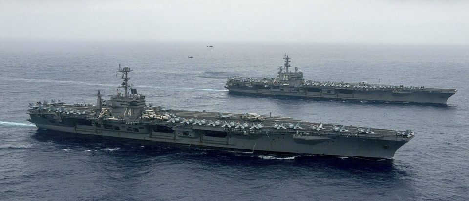 The Nimitz-class aircraft carriers USS John C. Stennis (CVN 74) and USS Ronald Reagan (CVN 76) in Philippine Sea