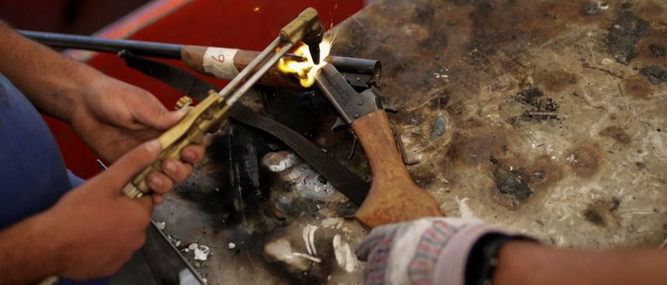 A weapon is being destroyed during an exercise to disable seized weapons in Caracas