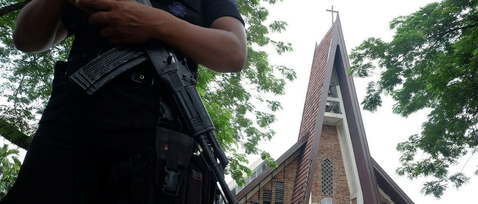 Police are seen outside Saint Joseph's catholic church after a suspected terror attack by a knife-wielding assailant on a priest during Sunday service in Medan, North Sumatra, Indonesia