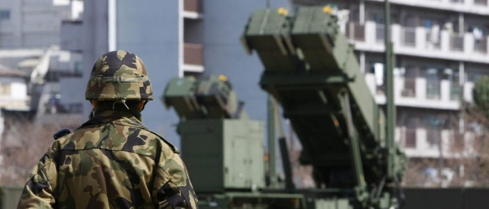 Japanese Self-Defence Force soldier stands guard near Patriot Advanced Capability-3 (PAC-3) missiles at the Defence Ministry in Tokyo