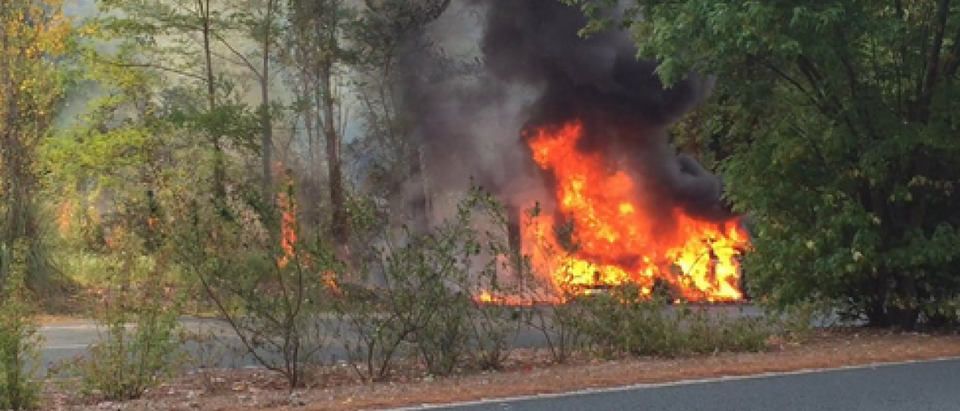 Tesla Model S bursts into flames and burns to the ground during test drive in France. (Screen shot/Twitter)