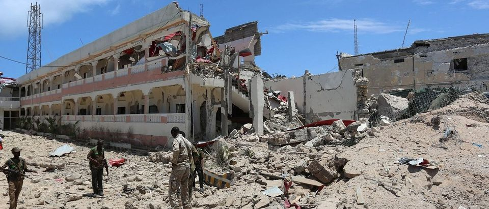 Security forces stand at the SYL hotel that was partly destroyed following a car bomb claimed by al Shabaab Islamist militants outside the president's palace in the Somali capital of Mogadishu