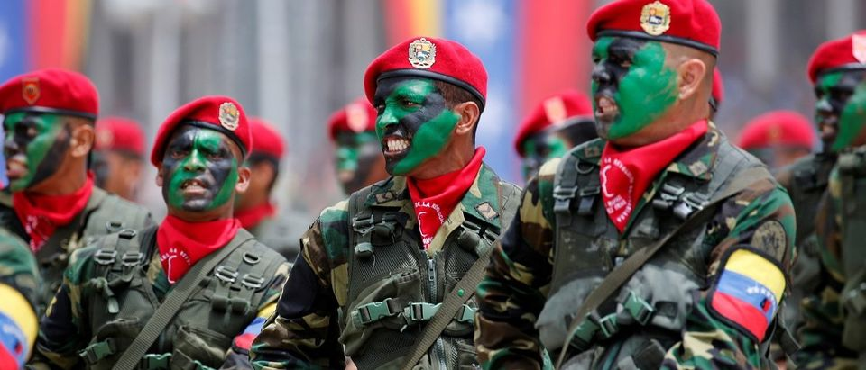 Soldiers with their faces painted march during a military parade to celebrate the 205th anniversary of Venezuela's independence in Caracas