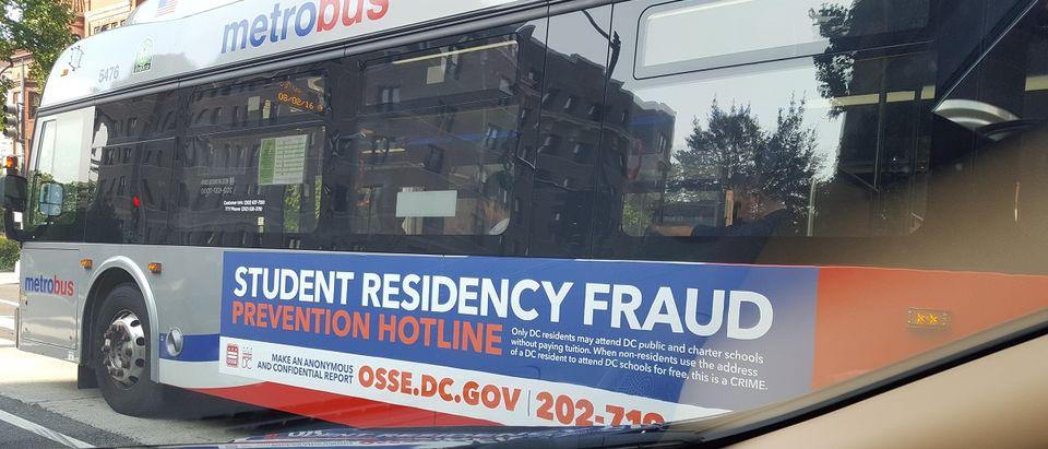School residency fraud bus ad