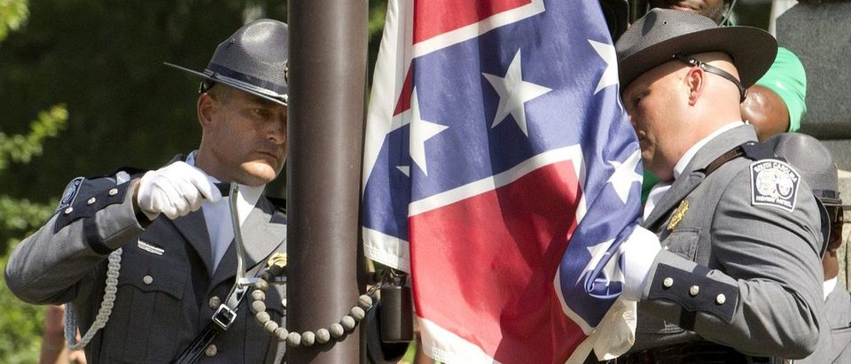 "The ConfederThe Confederate battle flag is permanently removed from the South Carolina statehouse grounds during a ceremony in Columbia, South Carolina July, 10, 2015. South Carolina removed the Confederate battle flag from the state capitol grounds on Friday to chants of ""USA, USA!,"" after three weeks of emotional debate over the banner, a symbol of slavery and racism to many, but of Southern heritage and pride to others. REUTERS/Jason Miczek."
