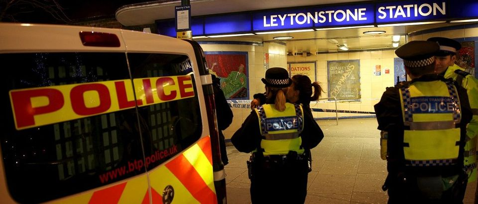 Police officers investigate a crime scene at Leytonstone underground station in east London