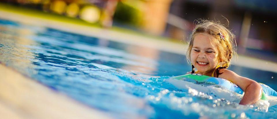 Girl Playing At Pool