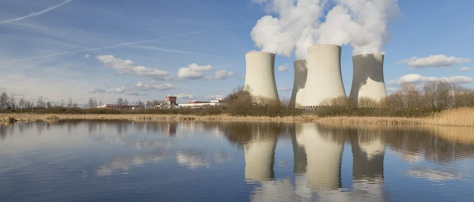 Nuclear power plant reflected in the small lake.(Shutterstock/Nadezda Murmakova)
