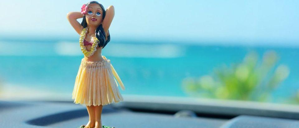 Hula girl doll. [Shutterstock/Maridav]