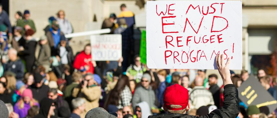 BOISE, IDAHO/USA - NOVEMBER 21, 2015: Guy telling the crowd we need to stop programs to help refugees in Boise, Idaho. Photo: txking / Shutterstock.com