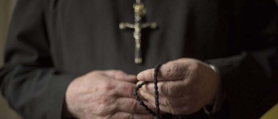 Hands of a priest. (Credit: Neville Elder / Shutterstock.com)