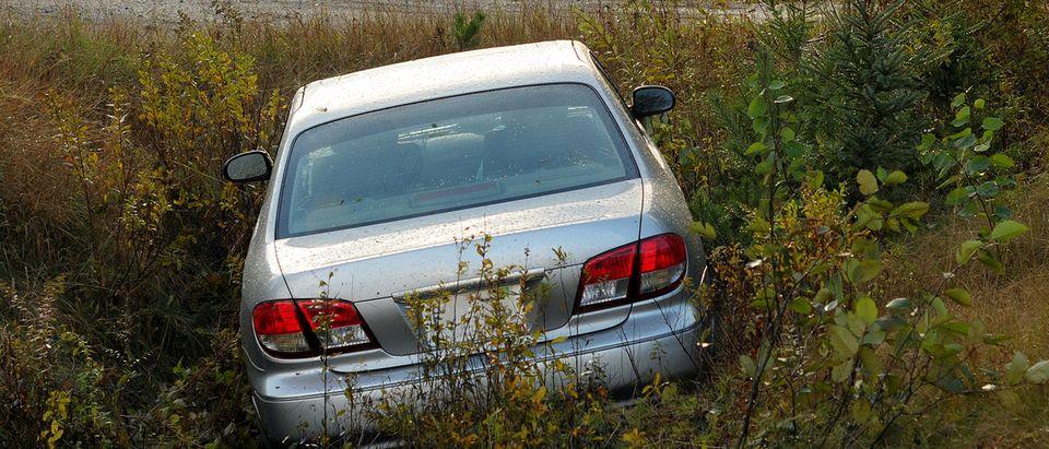 Car in a ditch (Credit: LesPalenik/Shutterstock)