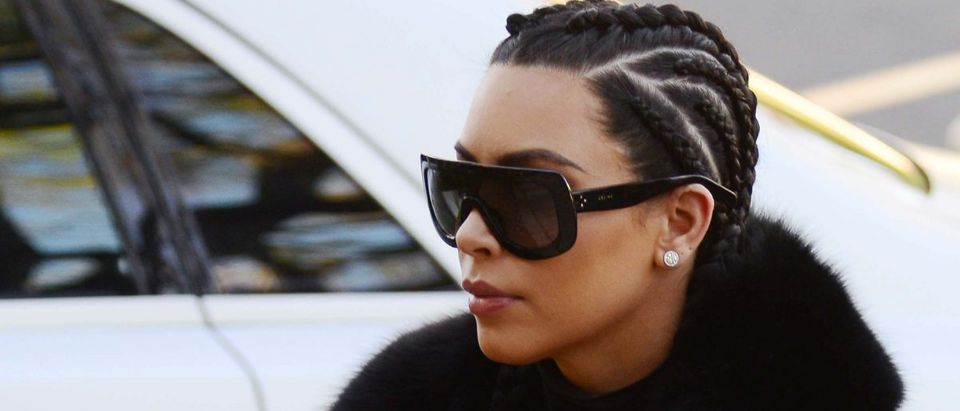 Kim Kardashian with her hair in braids heads to a meeting in Beverly Hills, Calif.