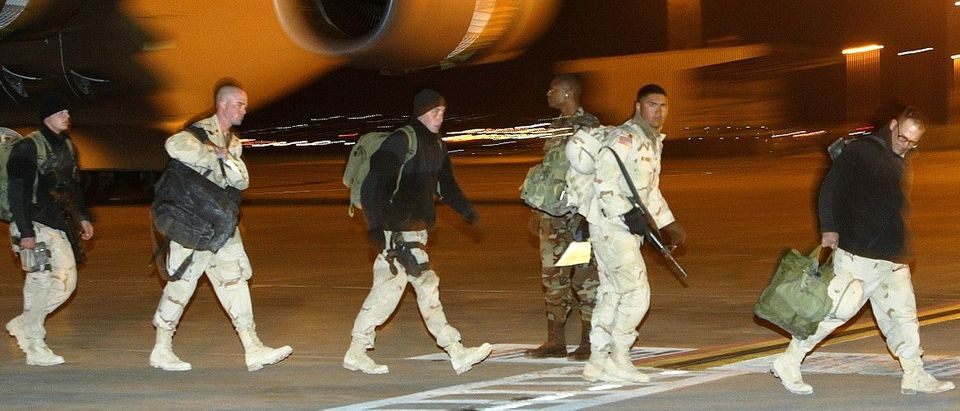 A group of U.S. troops from Iraq arrive at Incirlik Air Base near Turkey's southern city of Adana early February 25, 2004, for stopover on their way home after completing their missions in Iraq. Some 230 U.S. soldiers arrived at the base as they returned home after they completed their missions in Iraq. REUTERS/Fatih Saribas.