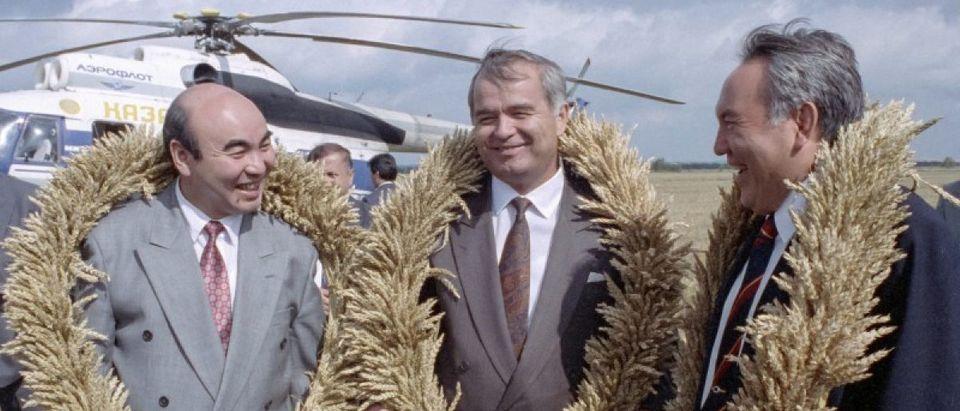 Uzbekistan's President Islam Karimov (C) poses with Kyrgyzstan's President Askar Akayev (L) and Kazakhstan's President Nursultan Nazarbayev while wearing presented wheat wreaths in Akmola region, near the town of Kokshetau in northern Kazakhstan, August 27, 1993. Picture taken August 27, 1993. REUTERS/Shamil Zhumatov/File Photo
