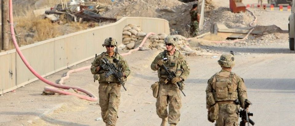U.S soldiers walk on a bridge within the town of Gwer northern Iraq