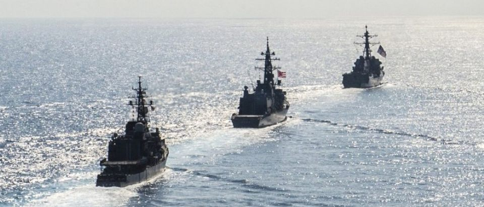 Arleigh Burke-class guided-missile destroyer USS Mustin (DDG 89) transits in formation with Japan Maritime Self-Defense Force ships JS Kirisame (DD 104) and JS Asayuki (DD 132) during bilateral training in South China Sea