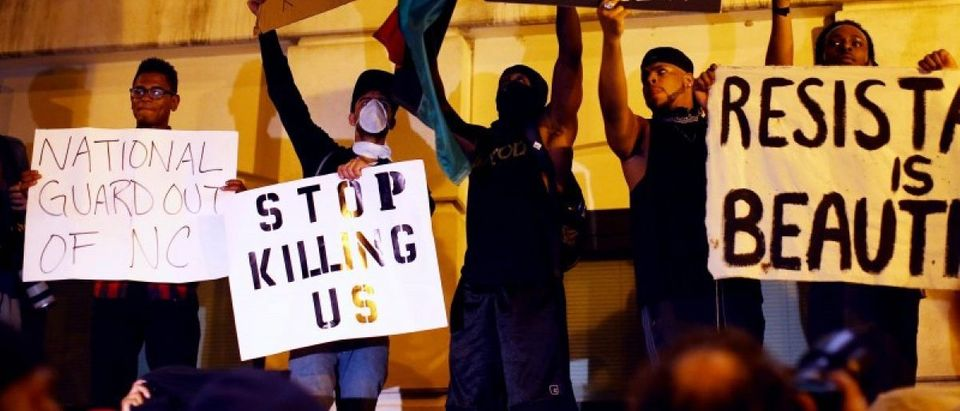 Protesters shout for the videos of the shooting from the steps of the police station during another night of protests over the police shooting of Keith Scott in Charlotte, North Carolina, U.S. September 22, 2016. REUTERS/Mike Blake