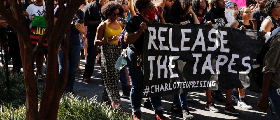 Marchers protest the police shooting of Keith Scott in Charlotte, North Carolina, U.S., September, 24, 2016. REUTERS/Jason Miczek