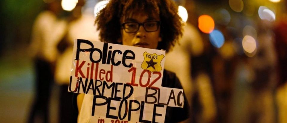 A marcher protests the police shooting of Keith Scott in Charlotte, North Carolina, U.S. September 24, 2016. REUTERS/Jason Miczek