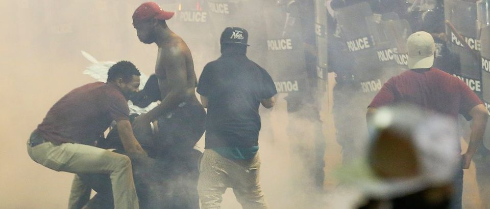 People maneuver amid tear gas in uptown Charlotte, N.C., during a protest of the police shooting of Keith Scott, September 21, 2016. (REUTERS/Jason Miczek)