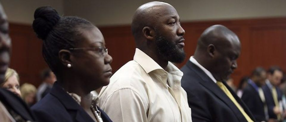 Trayvon Martin's partents, Sabrina Fulton (L) and Tracy Martin, stand in court during George Zimmerman's trial in Seminole circuit court July 5, 2013 in Sanford, Florida