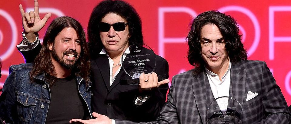 (L-R) Musician Dave Grohl presents musicians Gene Simmons and Paul Stanley of KISS the ASCAP Founders Award at the 32nd Annual ASCAP Pop Music Awards at the Loews Hollywood Hotel on April 29, 2015 in Los Angeles