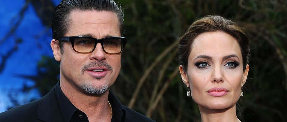 """Brad Pitt and Angelina Jolie attend a private reception as costumes and props from Disney's """"Maleficent"""" are exhibited in support of Great Ormond Street Hospital at Kensington Palace on May 8, 2014 in London"""