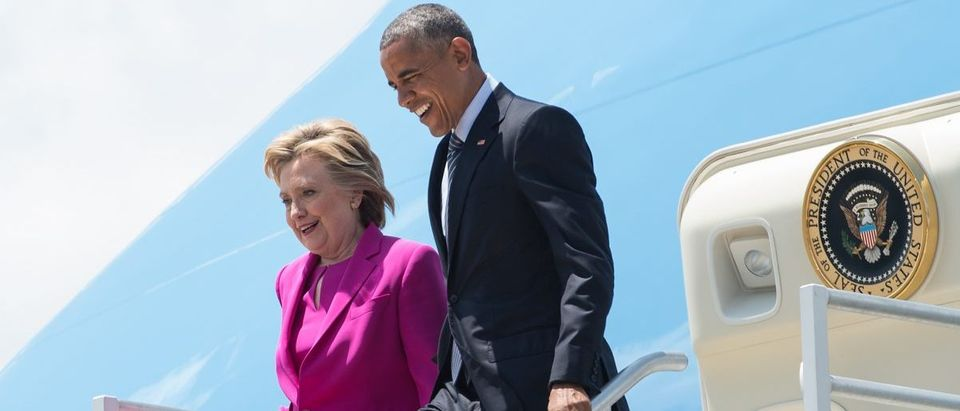 US President Barack Obama and Democratic presidential candidate Hillary Clinton walk off Air Force One in Charlotte, North Carolina, on July 5, 2016 to attend a Clinton campaign event.NICHOLAS KAMM/AFP/Getty Images