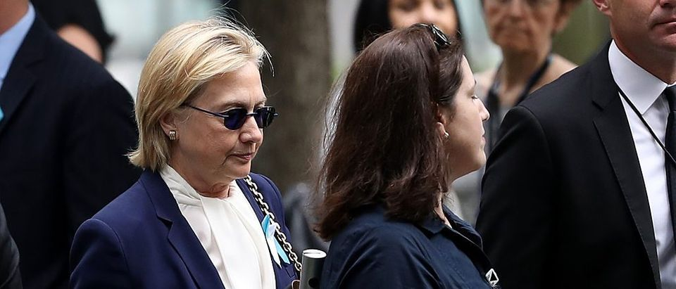 Hillary Clinton arrives with an unidentified woman at the September 11 Commemoration Ceremony at the National September 11 Memorial (Getty Images)