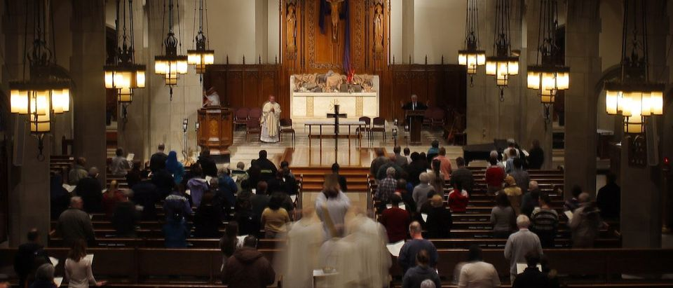 Faithful attend a Thanksgiving Mass for Pope Francis at Saint Ignatius church in Newton, Massachusetts