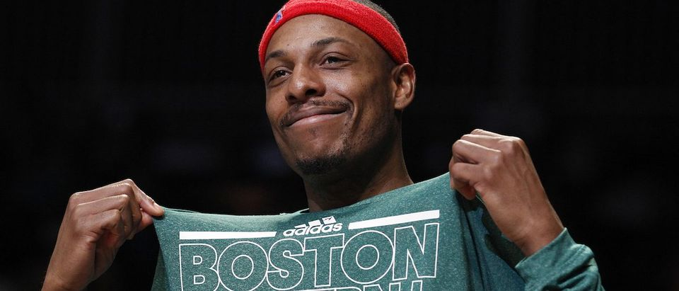 Boston Celtics small forward Paul Pierce smiles on the bench in the second half of their NBA basketball game against the Brooklyn Nets in New York
