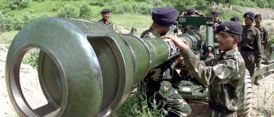 Indian soldiers clean a 105-mm artillery gun before retaliating to Pakistani shelling at Kanzalwan in Gurez sector, 160 kilometers (100 miles) north of Srinagar, July 4, 2002. India said on Thursday Pakistan's failure to curb militant incursions into its part of Kashmir has made it difficult to further reduce the tension between the nuclear-armed neighbours. REUTERS/Fayaz Kabli